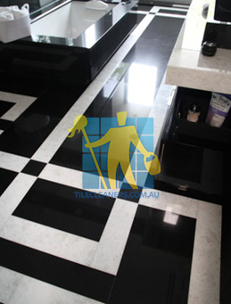 absolute black granite slab floor with white quartzite bands Nudgee