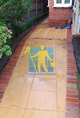 outdoor sandstone tiles pavers wet from cleaning with quarry tiles around Hendra